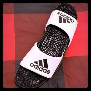 White adidas sandals with black adidas logo
